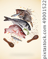 Flying raw sea fish with ingredients for cooking. Food preparation concept. 49001522
