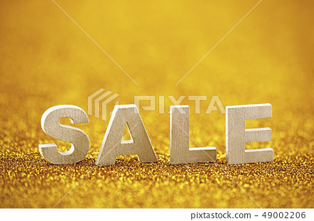 Word sale over golden glitter background  49002206