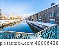 Beautiful landscape and cityscape of Otaru canal river in winter and snow season 49006438