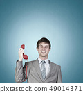 Businessman with red receiver 49014371
