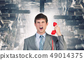 Businessman with red receiver 49014375