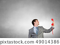 Businessman with red receiver 49014386