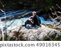 Senior man on a hiking trip alone 49016345