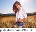 Happy woman  in golden wheat 49020413