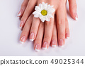 Beauty delicate hands with manicure. 49025344