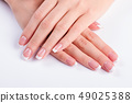 Neat female hands. 49025388