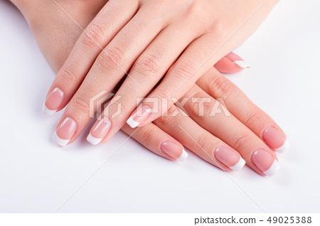 Neat female hands. 49025388