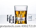 Whisky, whiskey or bourbon with ice 49027219