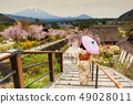 Japanese Kimono woman with sakura and mount Fuji 49028011