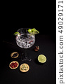 cocktail of gin and tonic on a black background 49029171