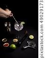 barman preparing a gin and tonic cocktail 49029173