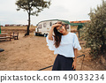 Beautiful young girl posing in nature on camera 49033234