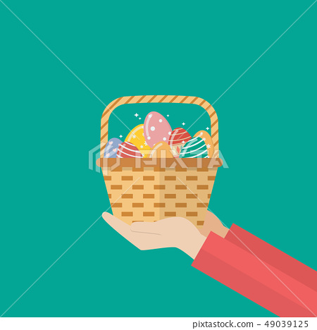 Hand holding basket with easter eggs 49039125