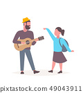 man musician singing and playing guitar woman dancing couple having fun together musical relax 49043911