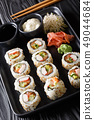 set of Japanese rolls uramaki served with sauces 49044684