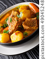 Potjiekos South African lamb stew with vegetables 49045248