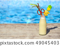 Glass of pinacolada cocktail standing on the 49045403