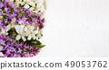 Lilac and spring blossom flowers arrangement 49053762