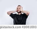 Portrait of worried bearded young man with closed eyes .Stressed young businessman 49061603