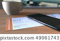 Boarding pass to Seoul and smartphone on the table in airport while travelling to South Korea. 3D 49061743