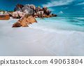 Granite rocks boulders, perfect white sand, turquoise water, blue sky. paradise beach Anse Cocos on 49063804