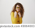 Beautiful young woman in a boxer stand posing on a grey background. Women's power and equality - 49064003