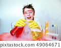 Crazy happy young scientist performing experiments in lab 49064671