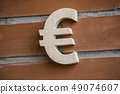 Wooden euro symbol on brick wall background 49074607