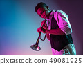 African American jazz musician playing trumpet. 49081925