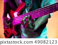 African American jazz musician playing bass guitar. 49082123