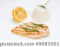 Chicken fillet cooked with rice and lemon close-up 49083001