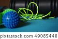 Massage ball roller for self massage, reflexology and myofascial release on blue 49085448