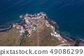 Top view of a coast. The buildings of the island 49086299