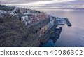 Top view of a coast. The buildings of the island 49086302