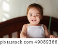 Portrait of happy smiling baby girl 49089366