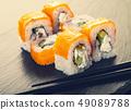 salmon sushi roll and chopsticks 49089788