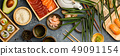 Overhead shot of ingredients for sushi on dark blue background 49091154