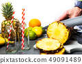 Man cutting pineapple slices for a smoothie 49091489