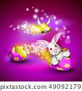 Funny bunny driving an egg shell 49092179