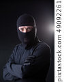 Robber man in bachelor with arms crossed. 49092261