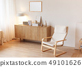 Modern minimalistic interior with chest of drawers an braided armchair. Scandinavian style. 49101626