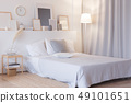 modern bedroom with floor lamp and decorations 49101651