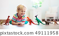 Child playing with toy dinosaurs. Kids toys. 49111958