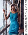 High fashion afro american model woman in blue bright dress posing in studio, portrait of beautiful 49114670