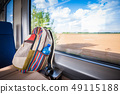 Backpack on the train near the window. Travel 49115188