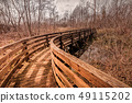 Wooden footbridge for hiking in nature. 49115202