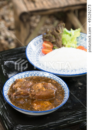 pork boiled with gravy sauce and fresh rice 49126273