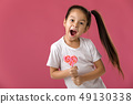 Beautiful cute little girl with a lollipop 49130338