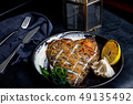 Flounder fillet roasted in a skillet with herbs and lemon 49135492
