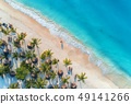 Aerial view of umbrellas, palms on the sandy beach 49141266